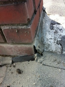 Chimney with bad mortar joints. Needs bad mortar removed and new mortar installed. Also known as tuck pointing. There is a large hole in the flashing that will cause severe water leakage into the home.